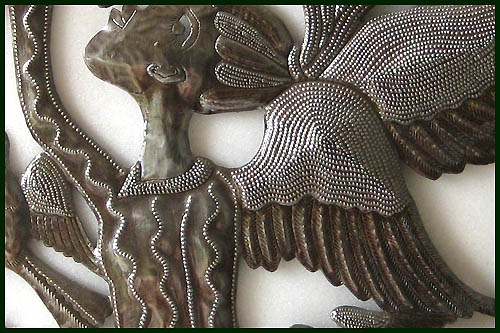 Close-up of angel wall hanging.