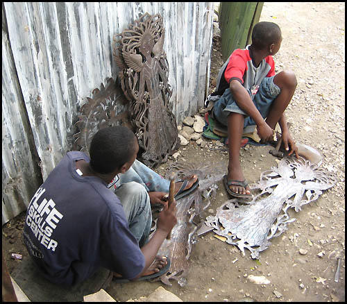 The making of Haitian Steel Drum Metal Art from recycled steel drums  - Haiti Metal Art - www.haitimetalart.com